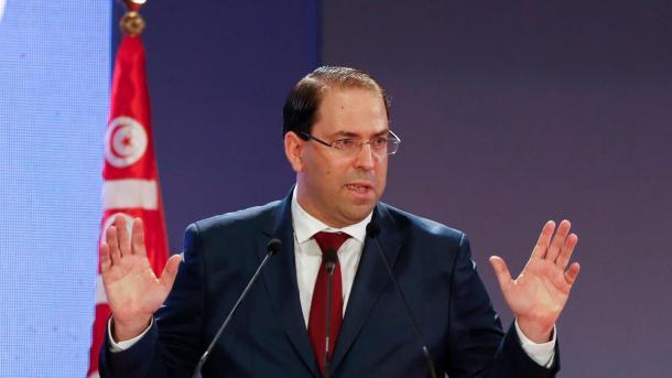 Le premier ministre tunisien, Youssef Chahed, mis à mal par la communauté internationale. (Photo par The National)